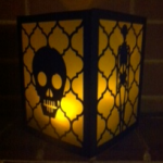 side view skull and skeleton lantern